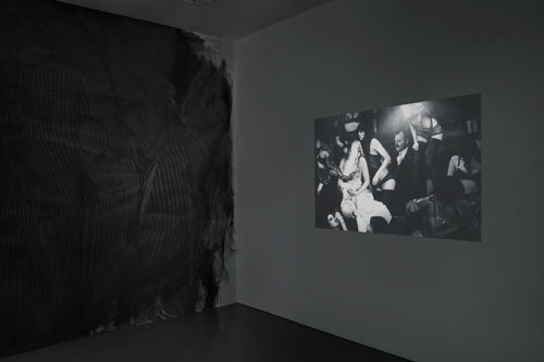 Fiona Banner in collaboration with Paolo Pellegrin and in association with the Archive of Modern Conflict. Mistah Kurtz – He Not Dead installation view at PEER, 2014 (3). Photograph: FXP Photography.