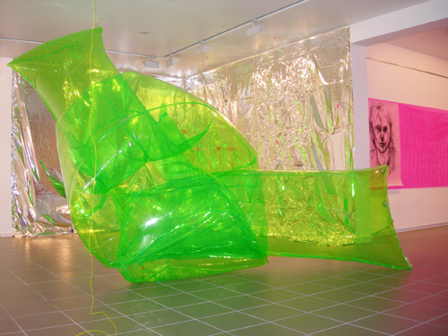 Irene Barberis. <em>Breath, Air, Light</em>, 2006. Float knot, self portrait, wall drawing in light. Float knot: 100cms x 350cms, self portrait, 100 x 280 cms. Fluorescent green pvc, artists breath, digital print on trace, flexible light, reflective foil, tape. © the artist  Photo artist. Cite International Des Arts, Gallery 2, Paris.
