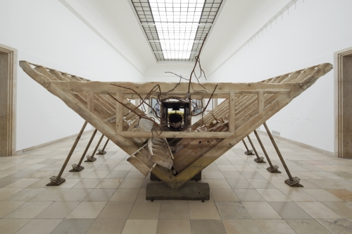 Matthew Barney. Boat of Ra, 2014. Wood, cast bronze, resin-bonded sand, steel, and gold plating, 132 × 600 × 288 in. Installation view, courtesy Laurenz Foundation, Schaulager, Basel. Photograph: Maximilian Geuter.