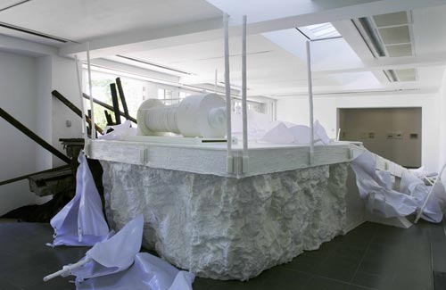 Matthew Barney. <em>Holographic Entry Point,</em> 2005. Self-lubricating plastic, polycaprolactone thermoplastic, shrimp shells, sea shells, cement, wood, steel, stainless steel, expanded polystyrene, vivac, pigment, acrylic paint, acrylic medium, sand, aquaplast, PVC. Installation at the Serpentine Gallery, London. Photograph &copy; Hugo Glendinning