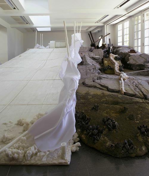 Matthew Barney. <em>Holographic Entry Point,</em> 2005. Self-lubricating plastic, polycaprolactone thermoplastic, shrimp shells, sea shells, cement, wood, steel, stainless steel, expanded polystyrene, vivac, pigment, acrylic paint, acrylic medium, sand, aquaplast, PVC. Installation at the Serpentine Gallery, London. Photograph © Hugo Glendinning