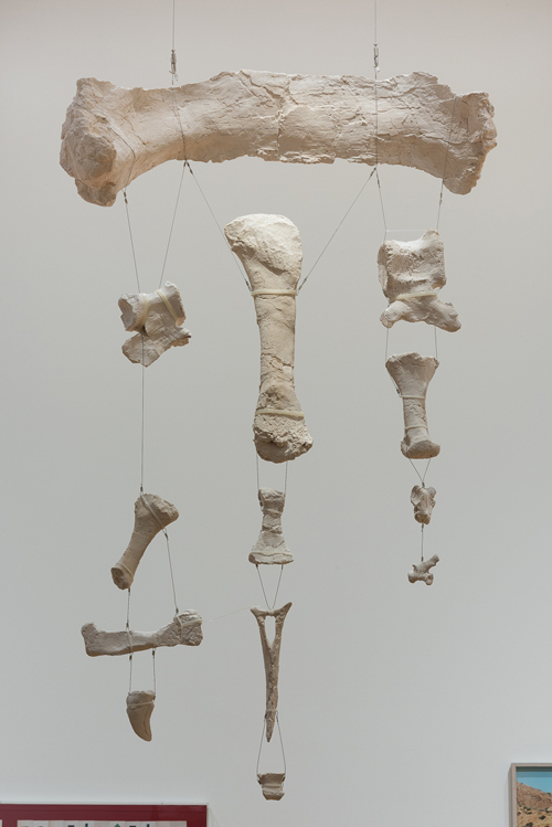 Yto Barrada. Untitled (mobile of Tazoudasaurus Naimi, bone fragments from the Late Early Jurassic Period, Morocco), 2015 plaster, wire, unique. Photograph: © Yto Barrada, Courtesy Pace London.