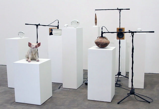 Oliver Beer. Making Tristan (for London), 2016.  Live installation, including Greek alabastron from 6th century BC, a Roman-Palestinian cooking pot from 1st century BC, artist's grandfather's ceramic pig and grandmother's chamber pot; microphones, mixer and speakers. Photograph: Martin Kennedy.