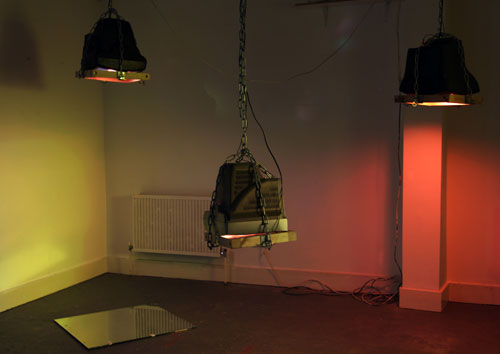 <p>Toby Ross-Southall.<em> Being Silent Isn't Strong (Installation View), </em>2010. DVD loop,  chain, wood, TVs, mirror, dimensions variable. © the artist.