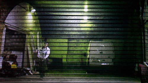 <p>Toby Ross-Southall.<em> Self-Effacement II (Bonny Street) (Installation View), </em>2010. DVD loop, projection, corrugated iron shutter, dimensions variable. © the artist.