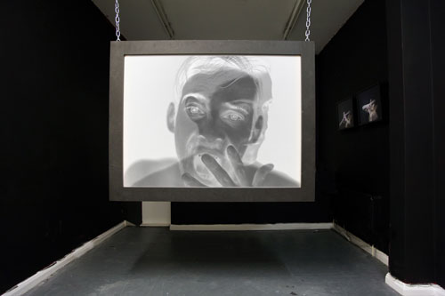 Toby Ross-Southall. Empirical Provocations, (Installation View), 2010. 144 slides, slide projectors, chain, rear projection PVC screen mounted in box frame, dimensions variable. © the artist.