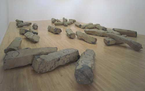The End of the Twentieth Century 1983-5. Basalt, clay and felt displayed 