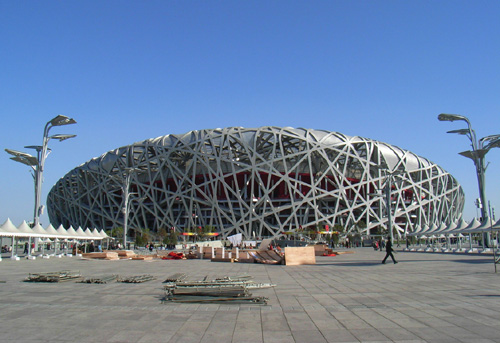 View of the National Stadium from the Olympic Plaza between the Stadium and the National Aquatics Centre.