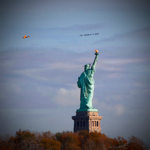 David Birkin. The Shadow of a Doubt, 2014. Aerial performance over New York Harbor, Veterans Day, 11/11.