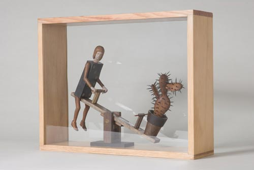 Andràs Böröcz. <em>See Saw</em>, 2006. Carved pencils, mixed media construction. 14 1/2 x 18 1/2 x 5 in. Courtesy Adam Baumgold Gallery.