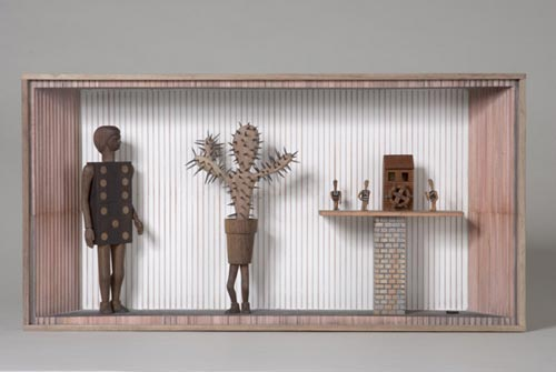 Andràs Böröcz. <em>Dominoes at the Watermill</em>, 2006. Carved pencils, mixed media construction 12 x 24 x 4 in. Courtesy Adam Baumgold Gallery.