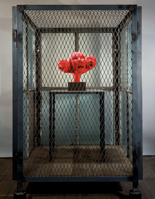 Louise Bourgeois. Cell XIV (portrait), 2000. Steel, glass, wood, metal and red fabric, 188 x 121.9 x 121.9 cm. Photograph: Christopher Burke, © The Easton Foundation/Licensed by DACS.