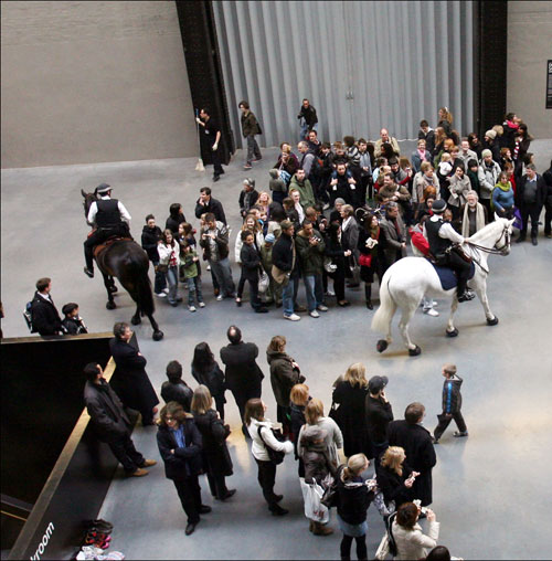Tania Bruguera. Tatlin's Whispers #5, 2008. Medium: Decontextualization of an action. Materials: Mounted police, crowd control techniques, audience, dimensions variable. Performance view at UBS Openings: Live The Living Currency, Tate Modern. Photograph: Sheila Burnett. Courtesy Tate Modern.