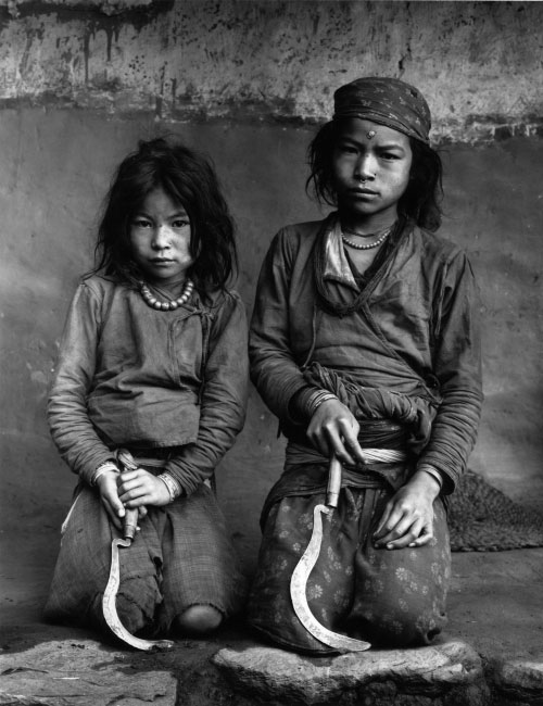 Kevin Bubriski. <em>Tamang sisters with sickles, Lachang village, Nuwakot,</em> 1984. Gelatin silver print, 18 x 14 in. Collection of Kevin Bubriski