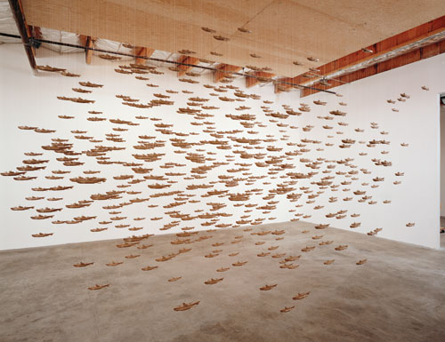 Chris Burden. All the Submarines of the United States of America, 1987. 625 miniature cardboard submarines, 96 x 240 x 144 in (243.8 x 609 x 365.2 cm). Dallas Museum of Art purchase with funds donated by the Jolesch Acquisition Fund, The 500 Inc., the National Endowment for the Arts, Bradbury Dyer, III, Mr. and Mrs. Bryant M. Hanley, Jr., Mr. and Mrs. Michael C. Mewhinney, Deedie and Rusty Rose, and Mr. and Mrs. William T. Solomon.