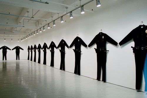 Chris Burden. L.A.P.D. Uniforms, 1993. Wool serge, metal, leather, wood, plastic, 88 × 72 × 6 in (223.5 × 182.8 × 15.2 cm) each. Collection: Marion Boulton Stroud, Philadelphia; and Collection: Fabric Workshop and Museum, Philadelphia. Photograph courtesy of Fabric Workshop.
