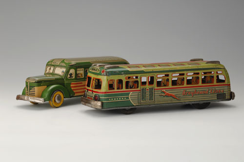 "Left: ""Noble Bus,"" mid-1950s. 12 x 3 3/8 x 3 3/4 in. (30.5 x 8.5 x 9.5 cm). Kaname Sangyo. Right: Greyhound Bus, mid-1950s. 12 5/8 x 3 1/2 x 3 1/2 in. (32 x 9 x 9 cm). Yoku Tanaka Collection. Photos: Tadaaki Nakagawa."