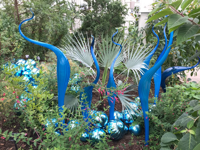 Dale Chihuly. Turquoise Marlins and Floats, blown glass, 2015. Royal Botanic Gardens, Kew, London 2019. Photo: Anna McNay.