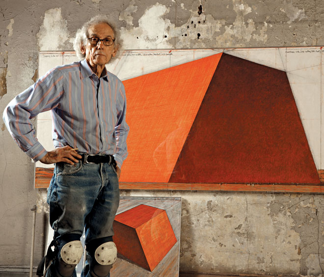 Christo in his studio with a preparatory drawing for The Mastaba, 2012. Photo: Wolfgang Volz. © 2012 Christo.