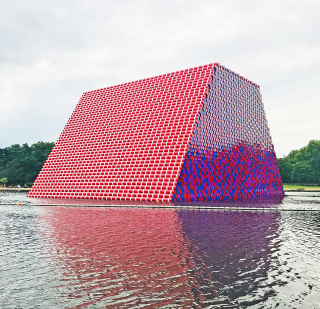 Christo. The London Mastaba, Serpentine Lake, Hyde Park, 2016-18. Temporary floating sculpture, 7,506 horizontally stacked barrels on a floating platform, 20(h) x 30(w)x 40(l) m, 600 metric tonnes. Photo: Martin Kennedy.