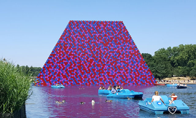 Christo. The London Mastaba, Serpentine Lake, Hyde Park, 2016-18. Temporary floating sculpture, 7,506 horizontally stacked barrels on a floating platform, 20(h) x 30(w)x 40(l) m, 600 metric tonnes. Photo: Miguel Angel.