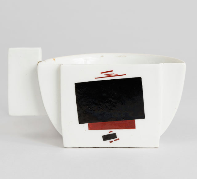 Kazimir Malevich, Ilya Chashnik. Half Teacup, 1923. Made by the State Porcelain Manufactory (former Imperial Manufactory), Petrograd enameled, glazed and molded porcelain, (h)6 x (w)10.8 x (d)5.2 cm ((h)2 3/8 x (w)4 1/4 x (d)2 1/16 in). Cooper Hewitt, Smithsonian Design Museum, Smithsonian Institution, New York. The Henry and Ludmilla Shapiro Collection; Partial gift and partial purchase through the Decorative Arts Association Acquisition and Smithsonian Collections Acquisition Program Funds.