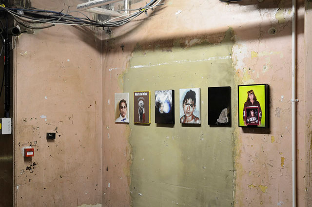Tamsyn Challenger, 400 Women, 2010. Portraits by various artists. Installation view, Shoreditch Town Hall Basement, London, 2010. Central image by Swoon. Photograph: Paul Tucker.