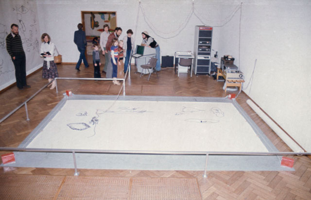 Harold Cohen's Drawing Machine at the Stedelijk Museum, in Amsterdam, in 1977. Courtesy Harold Cohen's archive.