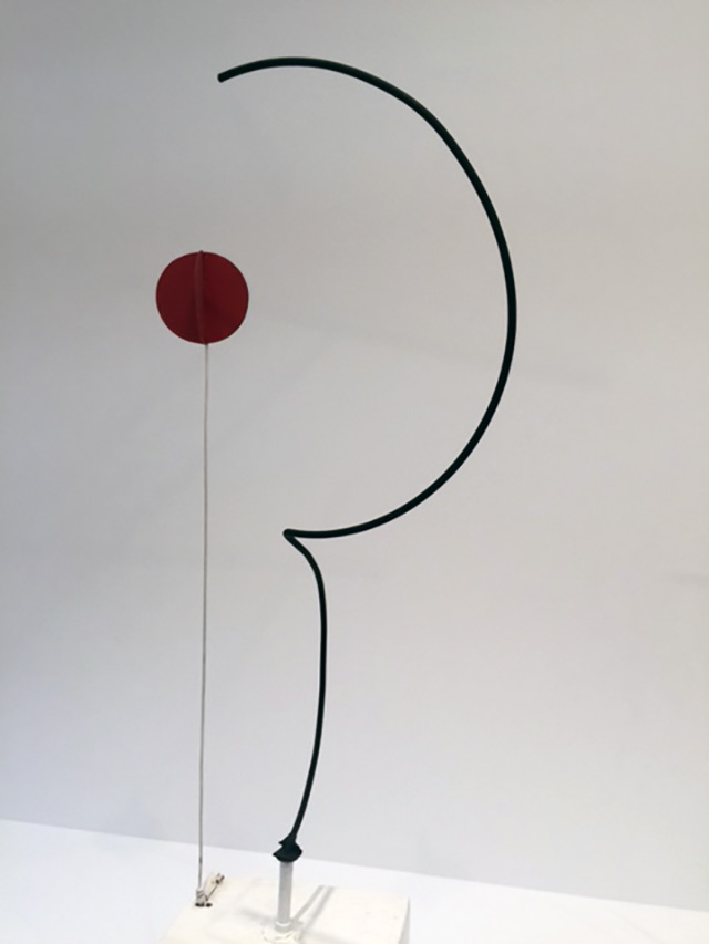 Alexander Calder. Half-circle, Quarter-circle, and Sphere, 1932. Sheet metal, wood, and paint, with motor, 76 5/8 × 35 1/2 × 25 in (194.6 × 90.2 × 63.5 cm). Whitney Museum of American Art, New York; purchase with funds from the Howard and Jean Lipman Foundation, Inc. Photograph: Jill Spalding.