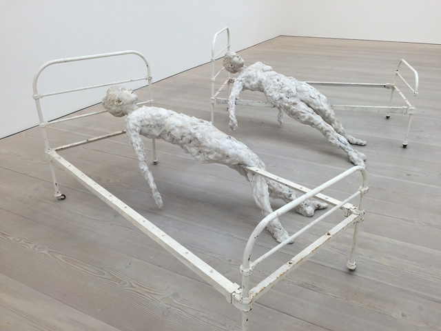 Virgile Ittah. Echoué au seuil de la raison, 2014. Mixed wax, marble dust, pair of unique cast iron beds, dimensions variable. Photograph: Martin Kennedy.