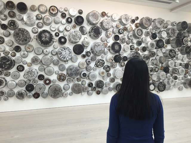 Maha Malluh. Untitled (Food for Thought series), 2015. 233 burnt pots, 4.40 x 10 m. Photograph: Martin Kennedy.