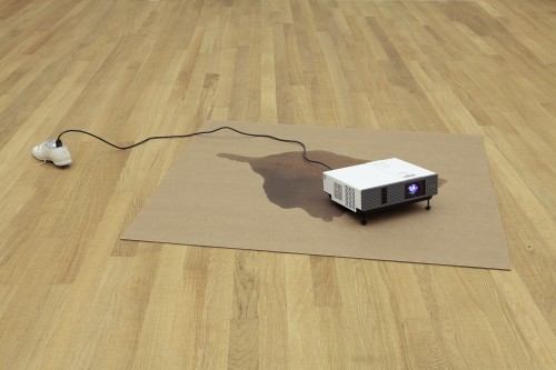 Paul Chan. Die All Jennies 1, 2013. Cardboard, concrete, cord, shoe, video projector with digital colour video, silent, 17.8 x 212.1 x 130.8 cm overall.