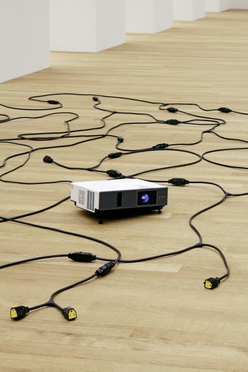 Paul Chan. Plow Highness, 2013. Cords and video projector with digital colour video, silent, 15.2 x 436.9 x 297.2 cm overall. Courtesy the artist and Greene Naftali, New York. © Paul Chan. Photograph: Tom Bisig, Basel.