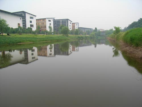 Phase I of the Xiangshan Campus with its reflection in the little stream that runs through the campus.