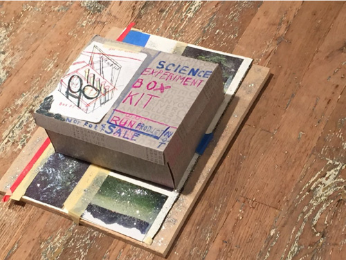 Susan Cianciolo. Science Experiment Box Kit, Science Box, Box of God Kit, 2003-15. Cardboard, glitter, glue, sketchbook (2014-2015), collage (2003), 6 x 14.5 x 19 in (15.24 x 36.83 x 48.26 cm). Unique. Photograph: Harry Hughes.