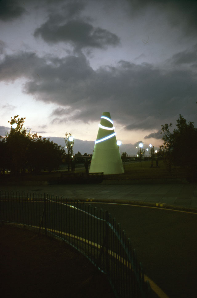 Liliane Lijn. White Koan, 1971. Work for Armada Way, Plymouth. Painted mild steel, neon tube, electric motor, height: 6.1 metres, base diameter: 3.6 metres. Arnolfini Archive at Bristol Record Office. Photographer unknown. © Liliane Lijn. All Rights Reserved, DACS 2016.