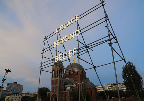 Nathan Coley. A Place Beyond Belief, 2012. Illuminated text on scaffolding, 6 × 6 × 3 m. Installation, National Gallery of Kosovo, Pristina.