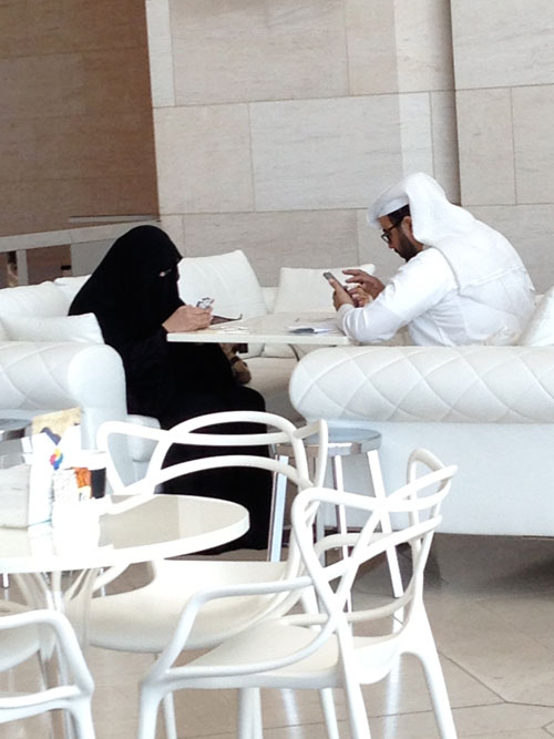 Two viewers taking a lunch break in Alain Ducasse restaurant in Qatar's Islamic Museum.