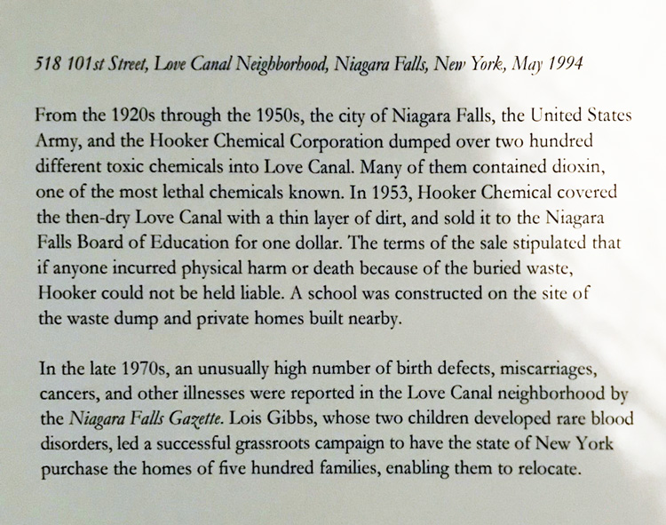 Joel Sternfeld. 518 101st Street, Love Canal Neighborhood, Niagara Falls, New York, May 1994, accompanying text. Photograph. Installation view photo: Christiana Spens.