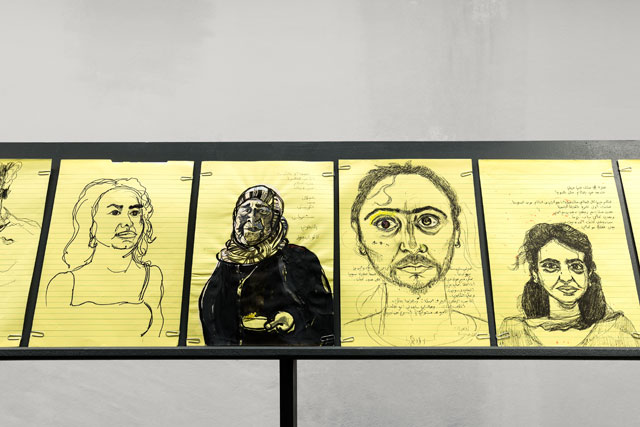 Mounira Al Solh. Works from I Strongly Believe in Our Right to Be Frivolous, 2012–17. Graphite on paper, installation view, Glass Pavilions on Kurt-Schumacher-Strasse, Kassel, documenta 14. Photograph: Fred Dott.