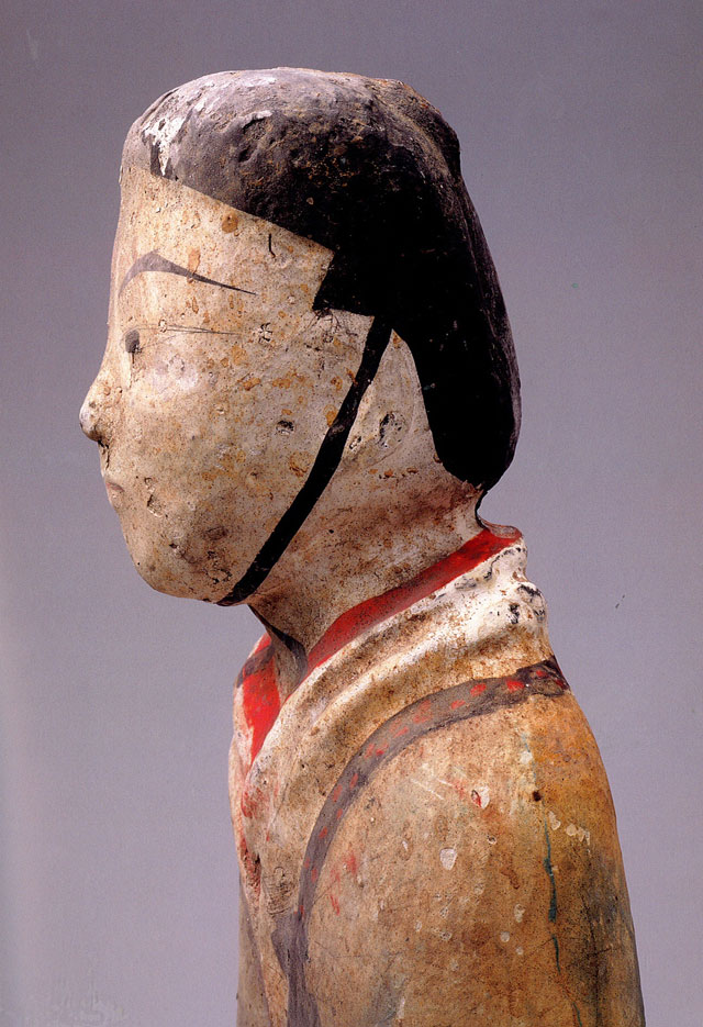 Painted earthenware tomb figurine with hands cupped in salutation, Western Han (206 BCE – 8 CE), H 54 cm (21 5/16 in), W 14 cm (5 9/16 in), excavated in 1986 from the King of Chu's tomb at Beidongshan. Collection of the Xuzhou Museum. 