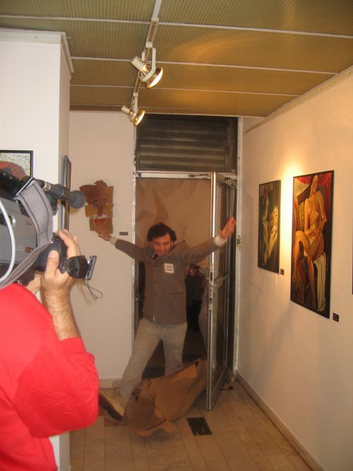 Dadadventure, September 9: Opening of the exhibition with 'Tristan Tzara' breaking through the brown paper door in the exhibition © Romanian Cultural Institute New York.