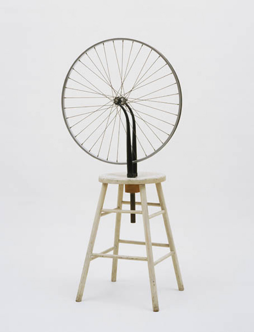 Marcel Duchamp, American, born France 1887-1968. <em>Bicycle Wheel (Roue de bicyclette)</em>, New York, 1951 (third version, after lost original of 1913).  Metal wheel mounted on painted wooden stool, 128.3 x 63.8 x 42 cm. The Museum of Modern Art, New York. The Sidney and Harriet Janis Collection, 1967  © 2006 Marcel Duchamp/Artists Rights Society (ARS), New York/ADAGP, Paris/Succession Marcel Duchamp.