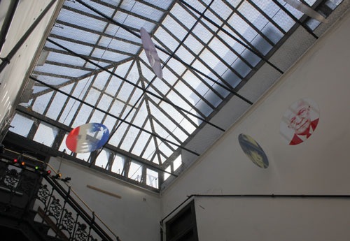 Chelsea Hotel. View of skylight and main staircase from 10th floor. Hanging artwork is an installation by Arthur Weinsten. Photograph: Miguel Benavides. © Studio International.