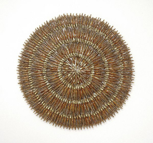 Tracy Heneberger. <em>Moon</em>, 2006. Anchovies, epoxy, shellac, resin, 24 x 24 x 1½ inches (61 x 61 x 3.8 cm). Courtesy of the artist. Photo: Tony Holmes.