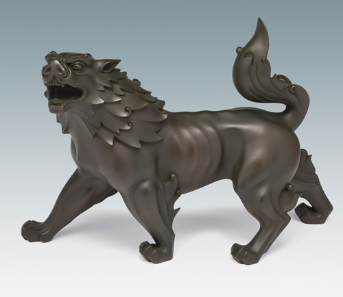 Tsuda Shinobu (1875–1946). <em>Okimono of a Roaring Shishi</em> (<em>Deluded Demons Flee North</em>), 1938. Bronze, 11 × 17¼ × 5½ in. This exhibition is organised and circulated by Art Services International, Alexandria, Virginia.