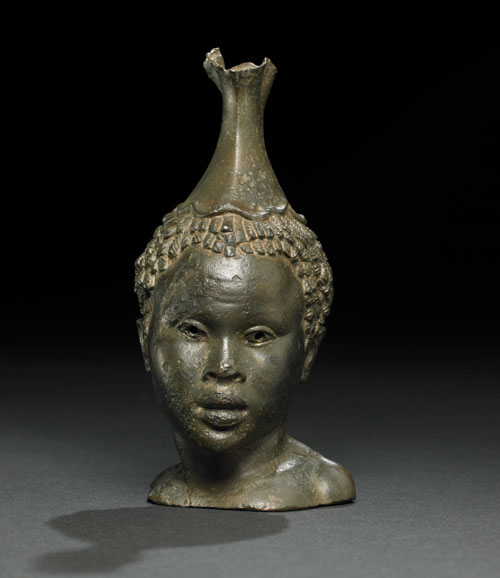 Bronze vessel in the form of the head of a young African woman. Hellenistic, 2nd century BC-1st century BC. Funded by The Art Fund. © The Trustees of the British Museum.