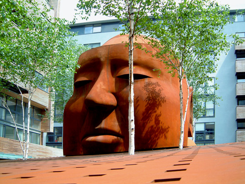 Antony Donaldson. Corten steel head of Alfred Hitchcock, approximately 4m in height and 7m from front to back, 18 tonnes, on the former site of Gainsborough Studios in north London.