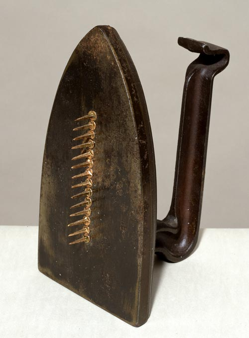 Man Ray. <em>Cadeau,</em> 1921. Iron and nails. Tate. Presented by the Tate Collectors Forum 2002 &copy; Man Ray Trust/ADAGP, Paris and DACS, London 2008