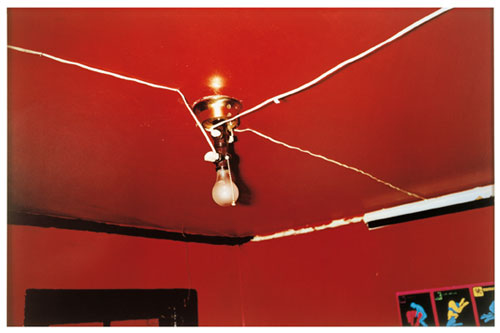 William Eggleston. The Red Ceiling, Greenwood, Mississippi, 1973. Dye transfer print, 35.2 × 55.1 cm (13.9 in × 21.7 in). Getty Center; Museum of Modern Art. © Eggleston Artistic Trust.